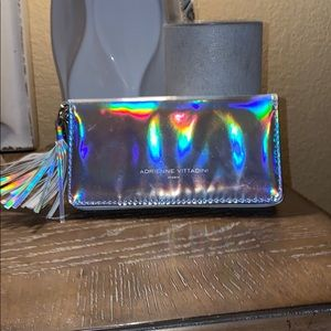 HOLOGRAPHIC WALLET WITH BUILT IN PORTABLE CHARGER